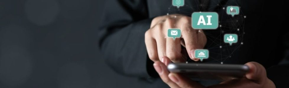 businessman-holding-smartphone-and-touch-sign-text-ai-artificial-intelligence-future-technology_t20_xvjbem